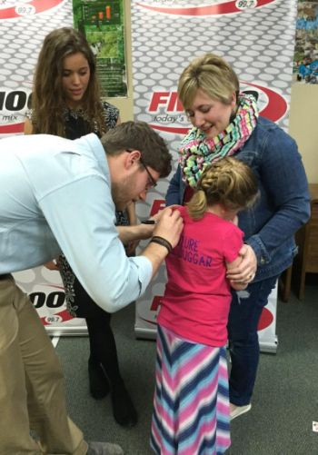 """Yes, Ben is signing the little girls' shirt, which reads """"Future Mrs. Duggar."""" And, yes, it's mildly creepy..."""